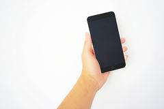 A hand is holding a smart mobile phone Royalty Free Stock Image