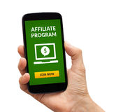 Hand holding smart phone with affiliate program concept on scree. Hand holding a black smart phone with affiliate program concept on screen. Isolated on white Royalty Free Stock Photo