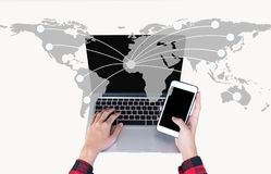 Free Hand Holding Smart Phone And Use Laptop Computer On World Map Network For Communication, Royalty Free Stock Image - 123317736