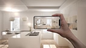 Hand holding smart phone, AR application, simulate furniture and interior design products in real home, architect designer concept. Blur background, modern Royalty Free Stock Photo
