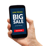 Hand holding smart phone with big sale concept on screen Royalty Free Stock Photos