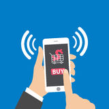 Hand holding smart phone with buy icon on the screen. vector Stock Photos