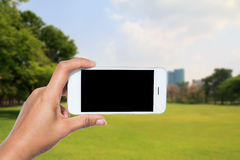 Hand holding smart phone Royalty Free Stock Photos