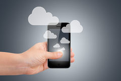 Hand Holding Smart Phone with Cloud Icons Royalty Free Stock Image