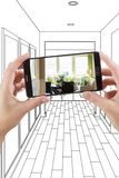 Hands Holding Smart Phone Displaying Photo of House Hallway Draw Royalty Free Stock Image