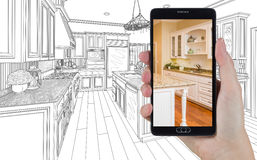 Hand Holding Smart Phone Displaying Photo of Kitchen Drawing Beh Stock Images