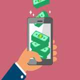 Hand holding smart phone and earning money stack Royalty Free Stock Images