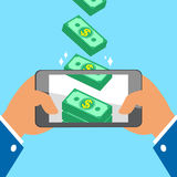 Hand holding smart phone and earning money stacks Stock Image