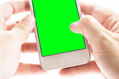Hand holding smart phone with green screen on whtie background Royalty Free Stock Image