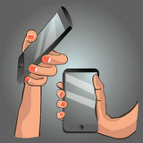 Hand holding smart phone. Hands holding a smart phone Royalty Free Stock Photos