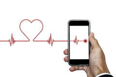Hand holding smart phone with heart rhythm ekg, and heart shape, isolated on white background Royalty Free Stock Photo
