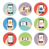 Hand holding smart phone icon vector Stock Images
