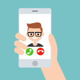 Hand holding a smart phone. Incoming call from young geek boy Royalty Free Stock Photos