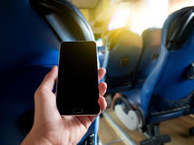 Hand holding smart phone inside bus Stock Photos