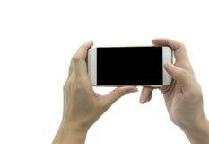 Hand holding smart phone isolated over white background - mockup Stock Photography