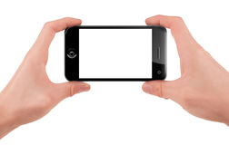Hand holding a smart phone Royalty Free Stock Photos