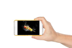 Hand holding Smart phone looking babecu isolated on white background Royalty Free Stock Photography