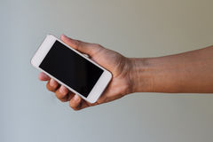Hand holding smart phone Royalty Free Stock Images