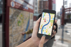 Hand holding smart phone with map gps navigation application. Concept guideline street travel stock image