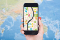 Hand holding smart phone with map gps navigation application. Concept guideline street travel royalty free stock photography