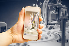Hand holding smart phone (Mobile Phone) with centrifuge. advance Royalty Free Stock Photos