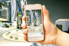 Hand holding smart phone (Mobile Phone) with centrifuge. advance Royalty Free Stock Photography