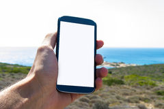 Hand Holding Smart Phone in Nature Royalty Free Stock Photos