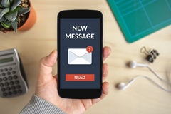 Hand holding smart phone with new message concept on screen Royalty Free Stock Images