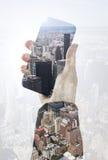 Hand holding smart phone Royalty Free Stock Image