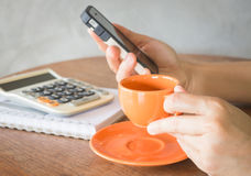 Hand holding smart phone online business Stock Photography