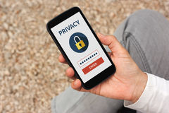 Hand holding smart phone with online privacy concept on screen. All screen content is designed by me Royalty Free Stock Photo