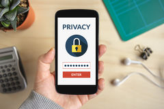Hand holding smart phone with online privacy concept on screen royalty free stock images