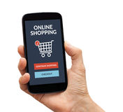 Hand holding smart phone with online shopping concept on screen Stock Photos