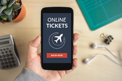 Hand holding smart phone with online tickets concept on screen Stock Photography