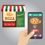 Hand holding smart phone, order pizza using a smartphone in pizz Stock Image