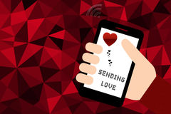 Hand holding smart phone over red low poly background Stock Images