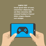 Hand holding smart phone, the screen icon game controller. Royalty Free Stock Photography