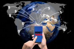 Hand holding smart phone sent money dollar bills flying away fro Royalty Free Stock Images