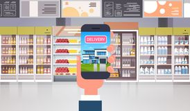 Hand Holding Smart Phone In Supermarket Order Grocery Products Delivery Food Shopping Concept. Flat Vector Illustration stock illustration