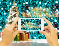 "Hand holding smart phone for take photo ""Merry Christmas "" Royalty Free Stock Photo"