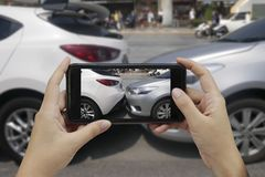 Hand holding smart phone take a photo at The scene of a car crash stock photos