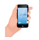 Hand holding smart phone on white background. Royalty Free Stock Photography