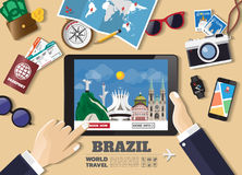 Hand holding smart tablet booking travel destination.Brazil famo Stock Photography