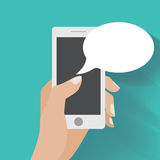 Hand holding smartphone with blank speech bubbles Royalty Free Stock Photography