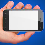Hand holding smartphone on blue background. Stock Photos