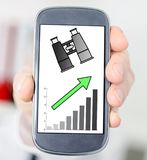 Business perspective concept on a smartphone. Hand holding a smartphone with business perspective concept Royalty Free Stock Photo