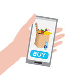 Hand holding smartphone with buy button Stock Photo