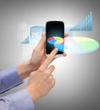 Hand holding smartphone with chart Stock Photo