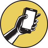 Hand Holding Smartphone Circle Woodcut Royalty Free Stock Photography