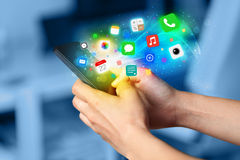 Hand holding smartphone with colorful app icons Royalty Free Stock Photo